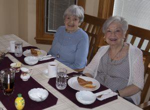 Two women eating at Maranatha Village dining room